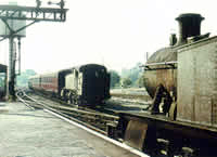 Vol 12: Prarie tanks 4157 &amp; 4107 pass at Ross on Wye, 2nd September 1964