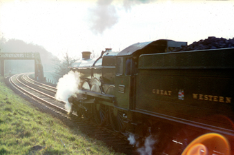 Heading into the setting sun, 7029 Clun Castle sounds to be in difficulty climbing Gresford Bank on Saturday 4th March 1967